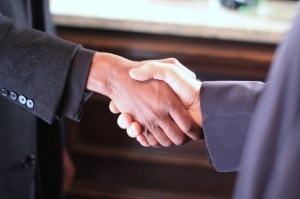 Black&White Handshake - Still_from_the_film_Colour_Blind_(2009) via Wikipedia